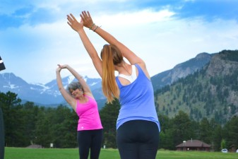 Yoga instructor Laura Collins leading class at YMCA of the Rockies.